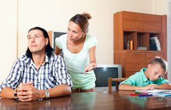 Family quarrel. Family of three with teenage son having quarrel at home royalty free stock images