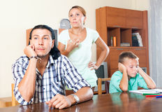 Family quarrel. Family of three with teenager boy having quarrel at home royalty free stock image