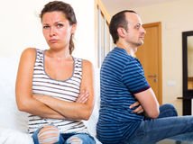 Family quarrel. Two sad adult sorting out their relationship. Focus on the woman Stock Photography