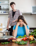 Family quarrel. Upset young woman against  man Stock Images