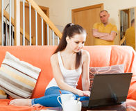 Family quarrel. Woman   with laptop Stock Photo