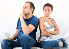 Family quarrel. Young sad couple sorting out their relationship Stock Images