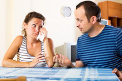 Family quarrel. Young unhappy family sorting out their relationship Stock Photos
