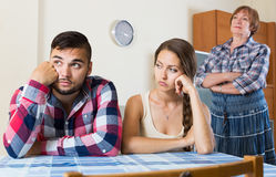 Family quarrels with the husbands mother. Young sad family quarrels with the husbands mother Stock Images