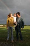 Family and rainbow Stock Photo