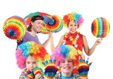Family with rainbow hat umbrella on head. Happy family with rainbow hat umbrella on head and colorfull paper garland in hands collage Royalty Free Stock Photos