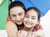 Family with a rainbow umbrella. Mother and daughter with a rainbow umbrella Royalty Free Stock Images