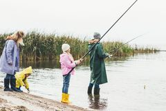 family in raincoats and boots royalty free stock photography