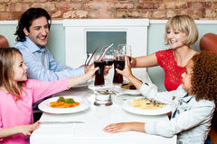 Family raising their glasses before eating Royalty Free Stock Images