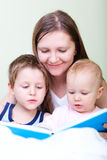 Family reading Stock Photography