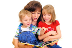 Family reading. Young mother is reading a book with her kids Stock Image
