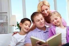 Family reading Stock Image
