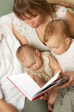 Family reading Stock Photos