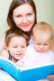 Family reading in bed Royalty Free Stock Photo