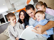Family reading a book Stock Photo