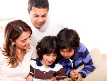 Family reading a book Stock Photography
