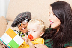 Family reading book Royalty Free Stock Photography