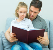 Family reading book. Stock Photos