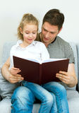 Family reading book. Stock Photo