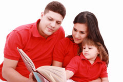 Family reading book at home Royalty Free Stock Photos