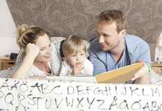 Family reading book Royalty Free Stock Images