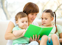 Family is reading book stock image