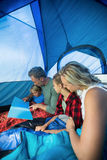 Family reading book in the tent Stock Photo