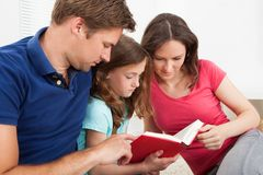 Family reading book Royalty Free Stock Image