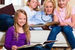 Family reading a book together Royalty Free Stock Photography
