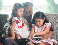 Family reading book together Royalty Free Stock Photography