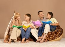 Family reading books Stock Image