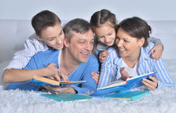 Family reading books Stock Images
