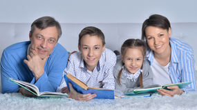 Family reading books Royalty Free Stock Images