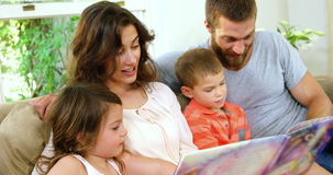 Family reading a children book stock video