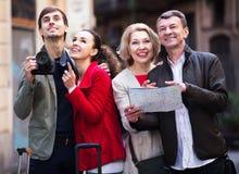 Family reading city map outdoors Stock Photos