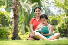 Family reading Stock Photos