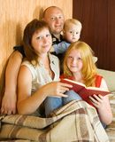 Family reading an interesting book stock image