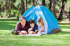 Family Reading Map At Campsite Stock Photos