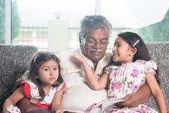 Family reading story book Stock Photo