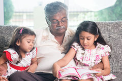 Family reading story book together Royalty Free Stock Images