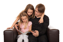 Family reading a story Stock Photos