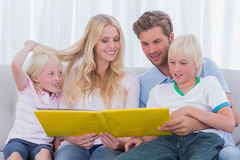 Family reading a story together Stock Image