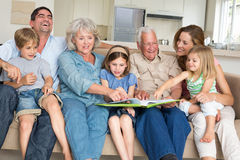 Family reading storybook at home Stock Photo