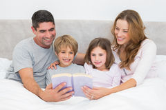 Family reading storybook Royalty Free Stock Image