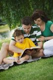 Family Reading Together Royalty Free Stock Image
