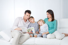 Family reads book Royalty Free Stock Images
