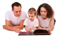 Family reads magazine Stock Image