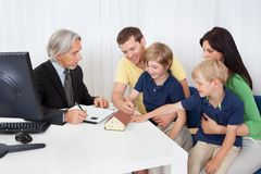 Family in real-estate agency. Talking construction planner Stock Image