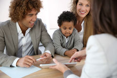Family in real-estate agency Royalty Free Stock Images