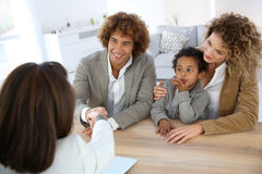 Family in real-estate agency. Family meeting real-estate agent for home purchase royalty free stock image